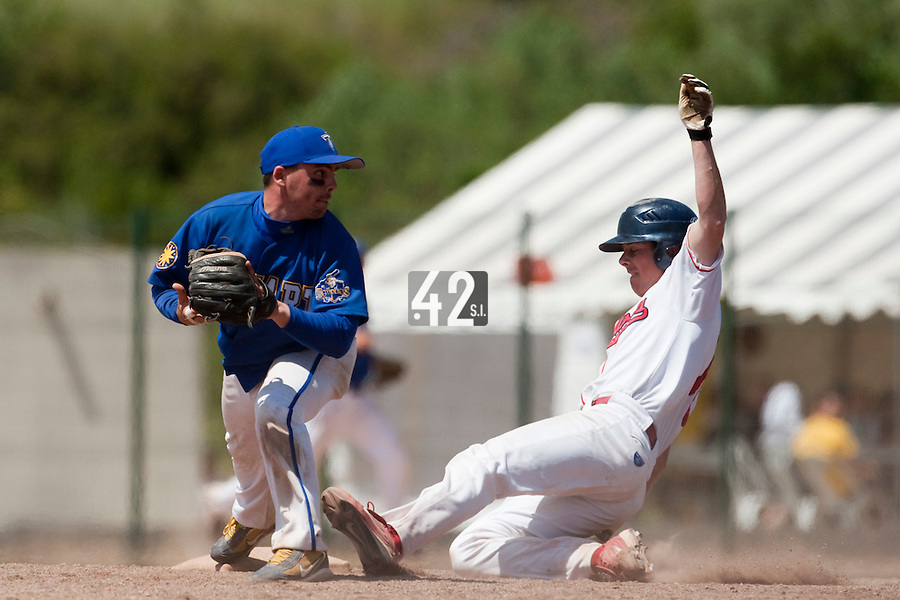 24 May 2009: Damien Teygeman of Senart fails to throw the ball to first base as Anthony Piquet of La Guerche slides into second base during the 2009 challenge de France, a tournament with the best French baseball teams - all eight elite league clubs - to determine a spot in the European Cup next year, at Montpellier, France. Senart wins 8-5 over La Guerche.
