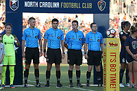 Cary, North Carolina  - Saturday August 05, 2017: Match officials John Krill, Elvis Osmanovic, Aaron Gallagher, and John Krill prior to a regular season National Women's Soccer League (NWSL) match between the North Carolina Courage and the Seattle Reign FC at Sahlen's Stadium at WakeMed Soccer Park. The Courage won the game 1-0.