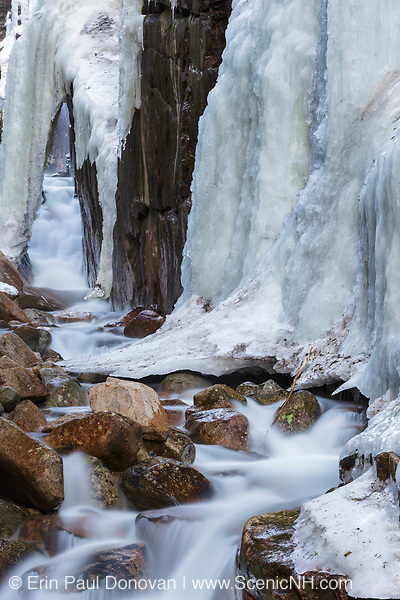 Ice build up on the walls of Flume Gorge in Franconia Notch State Park in Lincoln, New Hampshire USA during the spring months. Flume Brook travels through this gorge.