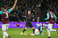 Granit Xhaka of Arsenal & Manuel Lanzini of West Ham United during the Premier League match between West Ham United and Arsenal at the Olympic Park, London, England on 13 December 2017. Photo by Andy Rowland.