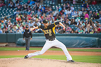 Steven Hensley (11) of the Salt Lake Bees delivers a pitch to the plate against the Oklahoma City Dodgers in Pacific Coast League action at Smith's Ballpark on May 25, 2015 in Salt Lake City, Utah.  (Stephen Smith/Four Seam Images)