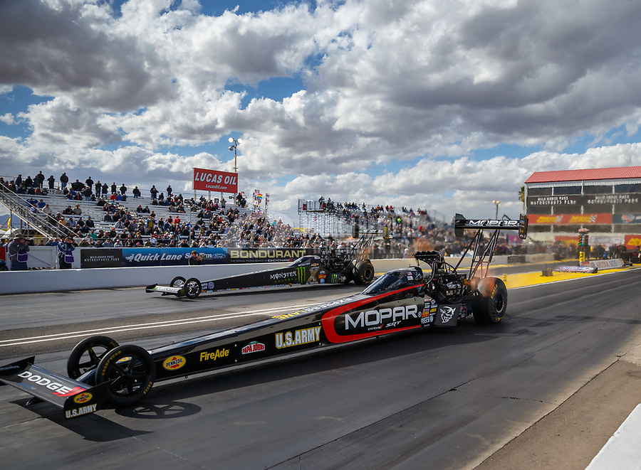 Feb 23, 2018; Chandler, AZ, USA; NHRA top fuel driver Leah Pritchett (near) races alongside Brittany Force during qualifying for the Arizona Nationals at Wild Horse Pass Motorsports Park. Mandatory Credit: Mark J. Rebilas-USA TODAY Sports