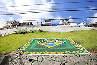 The Brazilian flag lies on a hill near Favelas in Salvador, one of the 12 host cities of the 2014 FIFA World Cup