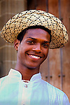 Man poses in a straw Montuno hat and embroidered shirt, the national dress for men in Panama in Casco Viejo, the old neighborhood of Panama City.