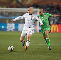 The USA's Michael Bradley fights for a loose ball with Algeria's Rafik Dhebbour.  USA played Algeria in a 2010 FIFA World Cup first round match at Loftus Versfeld Stadium in Tshwane/Pretoria, South Africa on Wednesday, June 23, 2010. The USA defeated Algeria 1-0 to win Group C and advance to the second round of the 2010 FIFA World Cup.