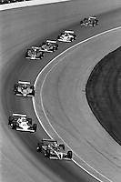 INDIANAPOLIS, IN - MAY 24: AJ Foyt drives his Coyote 81 1/Cosworth through Turn 1 ahead of Al Unser, Gordon Johncock and others during early laps of the Indianapolis 500 USAC/CART Indy Car race at the Indianapolis Motor Speedway in Indianapolis, Indiana, on May 24, 1981.