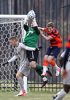 WASHINGTON, DC - NOVEMBER 25, 2012: Tomas Gomez (1) of Georgetown University saves from Louis Clark (7) of Syracuse University during an NCAA championship third round match at North Kehoe field, in Georgetown, Washington DC on November 25. Georgetown won 2-1 after overtime and penalty kicks.