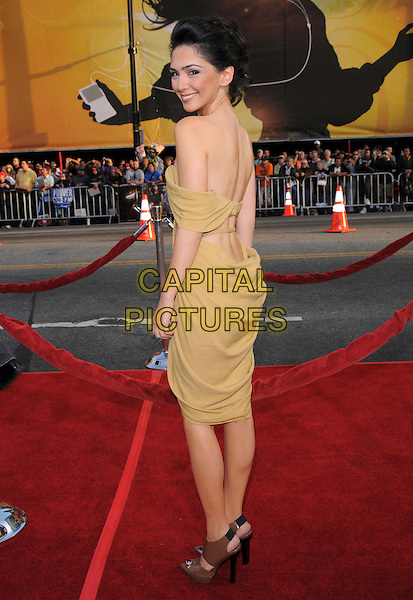 "NAZANINE BONAIDI.Attends Paramount Pictures' L.A. Premiere of ""Iron Man"" held at The Chinese Theatre in Hollywood, California, USA, April 30th 2008..full length strapless yellow dress brown shoes clutch bag open toe platforms back over shoulder                                                                     .CAP/DVS.©Debbie VanStory/Capital Pictures"