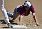 Belleville West's Hunder Grupe dives back to first base to avoid the pickoff. Belleville East defeated Belleville West 1-0 in a Class 3A Baseball Regional playoff game on Wednesday May 23, 2018. Tim Vizer | Special to STLhighschoolsports.com