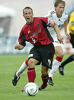 26 June 2004:  Dallas Burn Forward Jason Kreis in action against DC United at Cotton Bowl in Dallas, Texas.   Jason Kreis scored his 89th goal to become a leading scorer in MLS History.   DC United and Dallas Burn are tied 1-1 after the game.   Credit: Michael Pimentel / ISI