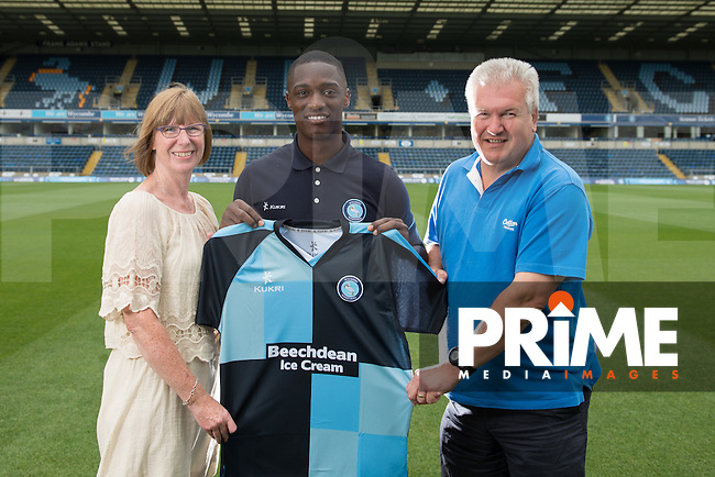 Anthony Stewart of Wycombe Wanderers is handed his Home shirt by his sponsor during Wycombe Wanderers Team Photoshoot 2015  at Adams Park, High Wycombe, England on 3 August 2015. Photo by PRiME Media Images