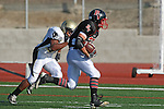 Palos Verdes, CA 11/14/09 - Max Baiz (PV# 7) runs for some yardage during the Palos Verdes-Peninsula football game.