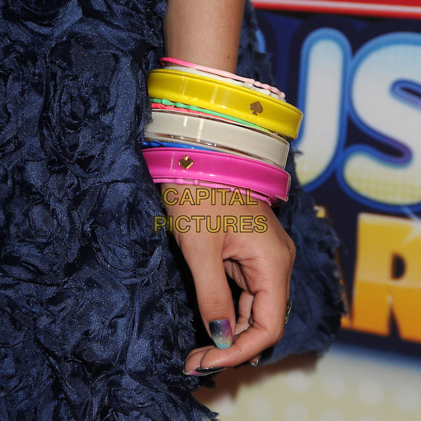 Bella Thorne's hand .At the Radio Disney Music Awards 2013 held at Nokia Theatre LA Live, Los Angeles, California, USA, .27th April 2013..detail hand bracelet bangles pink blue navy multi-coloured perspex yellow ombre nails nail art varnish polish manicure .CAP/ADM/BP.©Byron Purvis/AdMedia/Capital Pictures