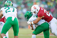 STANFORD, CA - SEPTEMBER 21: Andrew Pryts #25 of the Stanford Cardinal tackles CJ Verdell #7 of the Oregon Ducks during a game between University of Oregon and Stanford Football at Stanford Stadium on September 21, 2019 in Stanford, California.