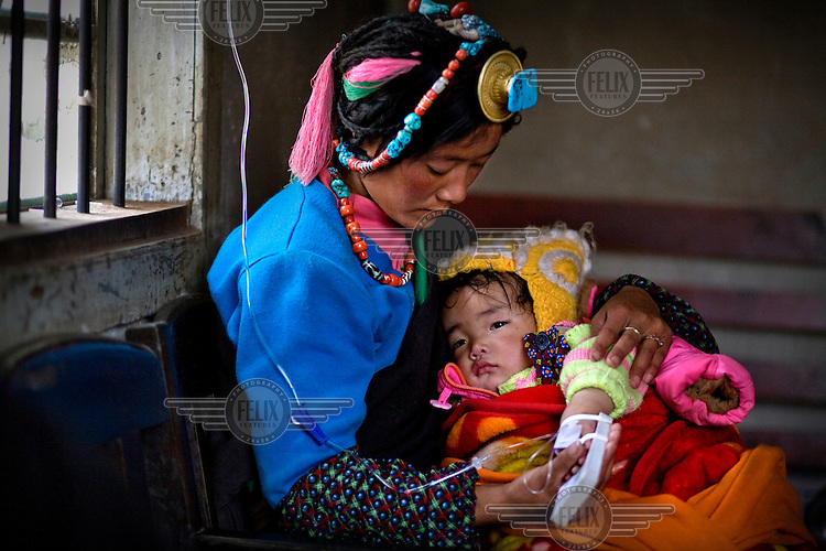 A nomadic Khampa child receives basic medical treatment in a small clinic in Dengke.