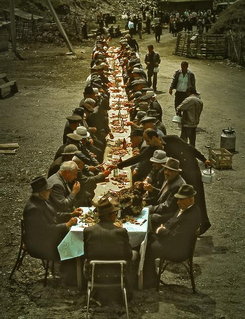 Men in Cacasus region of Russian feast after funeral