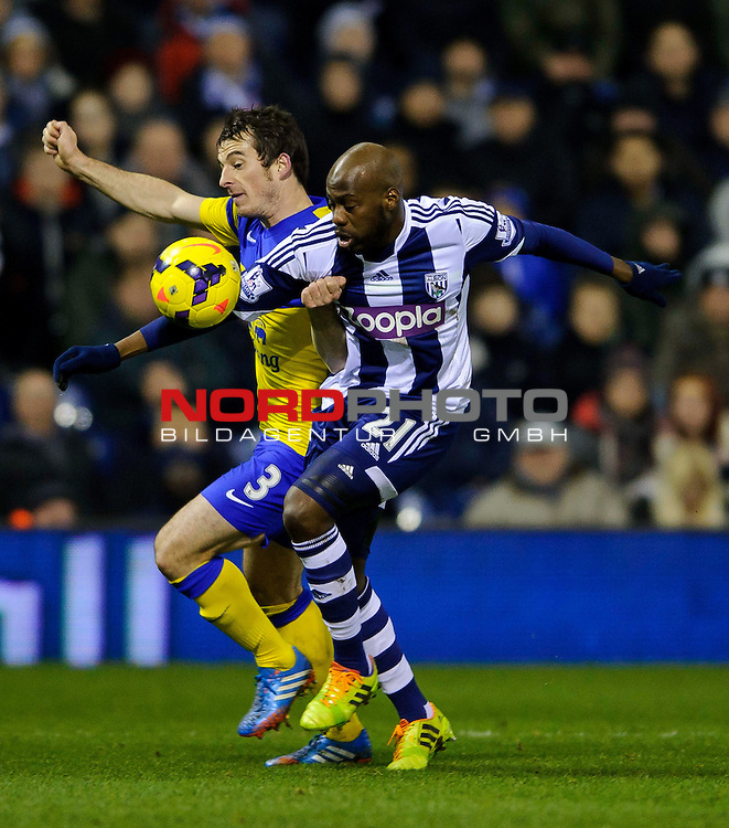 West Brom Midfielder Youssuf Mulumbu is challenged by Everton Defender Leighton Baines (ENG) -  - 20/01/2014 - SPORT - FOOTBALL - The Hawthorns Stadium - West Bromwich Albion v Everton - Barclays Premier League.<br /> Foto nph / Meredith<br /> <br /> ***** OUT OF UK *****