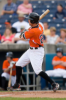 Jeff Fiorentino #20 of the Norfolk Tides follows through on his swing versus the Toledo Mudhens at Harbor Park June 7, 2009 in Norfolk, Virginia. (Photo by Brian Westerholt / Four Seam Images)
