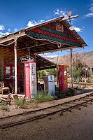 Old abandoned gas station in Chloride, a mining ghost town, but it never completely died, and therefor has the old abandoned buildings and mining equipment,  not having completely died it also has restaurants, gift shops, a silversmith, art gallery's and more.  At one time chloride had over 72 mines operating.