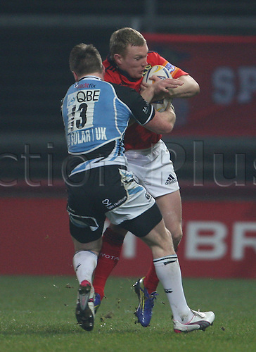 01.12.2012 Limerick, Ireland. Keith Earls is tackled by Alex Dunbar, during the RaboDirect PRO12 game between Munster and Glasgow Warriors from Thomond Park.