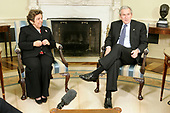 Washington, D.C. - March 7, 2007 -- United States President President George W. Bush, right, speaks to the media as former United States Secretary of Health and Human Services Donna Shalala, left, looks on after their meeting in the Oval Office of the White House on Wednesday, March 7, 2007 in Washington, DC. President Bush has named Shalala and former United States Senator Bob Dole (Republican of Kansas) to head his newly established bipartisan Commission on Care for Americaís Returning Wounded Warriors to investigate the problems at Walter Reed Army Medical Center. The commission has to turn in its final report by June 30, 2007.  <br /> Credit: Alex Wong - Pool via CNP
