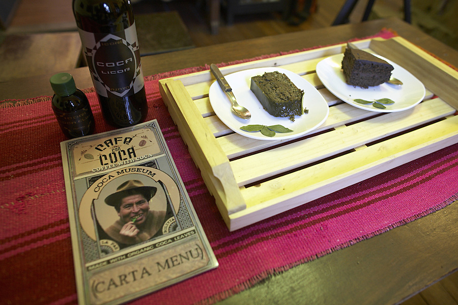"The coca museum in La Paz, Bolivia.  Menu, coca cake, coca elixir and a bottle of coca liquor  in the upstairs ""Coca Cafe""."