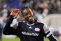 Shalrie Joseph (21) of the New England Revolution waves to fans after the game. The New York Red Bulls defeated the New England Revolution 2-0 during a Major League Soccer (MLS) match at Red Bull Arena in Harrison, NJ, on October 21, 2010.
