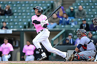 Rochester Red Wings outfielder Chris Colabello #24 during a game against the Columbus Clippers on May 12, 2013 at Frontier Field in Rochester, New York.  Rochester defeated Columbus 5-4 wearing special pink jerseys for Mother's Day.  (Mike Janes/Four Seam Images)
