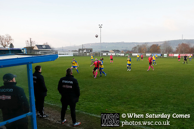 All eyes on the ball in front of the Jamie Vardy Stand. Stocksbridge Park Steels v Pickering Town, Evo-Stik East Division, 17th November 2018. Stocksbridge Park Steels were born from the works team of the local British Steel plant that dominates the town north of Sheffield.<br /> Having missed out on promotion via the play offs in the previous season, Stocksbridge were hovering above the relegation zone in Northern Premier League Division One East, as they lost 0-2 to Pickering Town. Stocksbridge finished the season in 13th place.