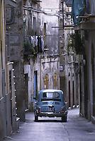 Una vecchia Fiat 500 attraversa i vicoli del centro di un tipico paesino del Sud Italia..Photo Antonello Nusca/Buenavista photo