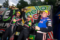 Jun 21, 2015; Bristol, TN, USA; NHRA winners, top fuel driver Richie Crampton, pro stock driver  Erica Enders-Stevens and funny car driver Matt Hagan celebrate after winning the Thunder Valley Nationals at Bristol Dragway. Mandatory Credit: Mark J. Rebilas-