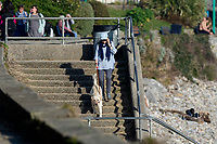 WEATHER PICTURE WALES<br /> A dog walker during the unusually warm weather in Langland Bay near Swansea, Wales, UK. Wednesday 27 February 2019