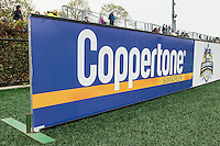 Allston, MA - Saturday, May 07, 2016: Coppertone sign board at a regular season National Women's Soccer League (NWSL) match at Jordan Field.