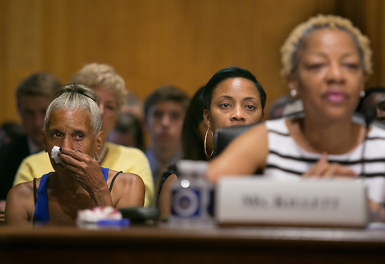 "UNITED STATES - August 4: A woman in the audience wipes away tears as Sandra Killett, a parent advocate from New York City, finishes her testimony during the Senate Finance Committee hearing on ""A Way Back Home: Preserving Families and Reducing the Need for Foster Care"" in the Dirksen Senate Office Building in Washington, Tuesday, August 4, 2015. (Photo By Al Drago/CQ Roll Call)"