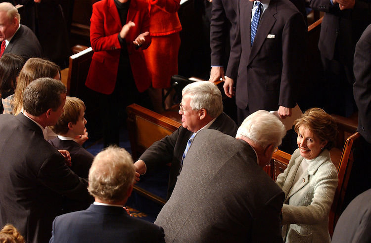 House24_010703 -- J. Dennis Hastert, R-Ill., and Nancy Pelosi, D-CA., during the opening session of the 108th Congress.