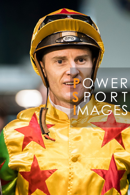 Jockey #4 Zac Purton riding Savannah Wind celebrating after winning race 2 during Hong Kong Racing at Happy Valley Race Course on November 22, 2017 in Hong Kong, Hong Kong. Photo by Marcio Rodrigo Machado / Power Sport Images