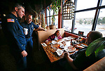 Casey Drews and Lance Caras, with Carson City Fire, talk with guests Kaelynn Briggs, 10, and her dad Robert as first responders from around the area wait on diners at Bodines as part of the Feast with a Hero fundraiser in Carson City, Nev., on Saturday, Dec. 15, 2018. <br /> Photo by Cathleen Allison/Nevada Momentum