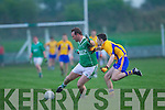 Jay O'Brien of Ballyduff  feels the pressure from Ger Hartnett of Beaufort last Saturday night in Ballyduff.