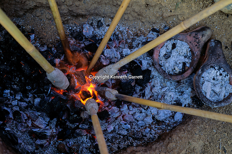 Copper smelting in clay crucible, reconstruction using traditional methods, experimental archaeology, Shiqmim, Israel, Copper Age site