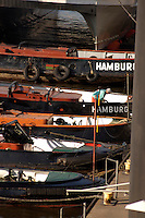 Five river barges at Jetty on the river Elbe, Hamburg, Germany.