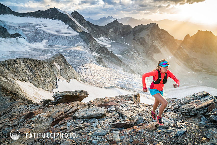 Trail running high in the Swiss Alps near the Glacier de Moiry, Switzerland
