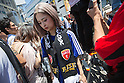 June 15, 2014, Tokyo, Japan - A dejected Japanese football fan after watching the FIFA World Cup Brazil 2014 Group C match between Japan and Cote d'Ivoire in the Shibuya district in Tokyo on Sunday, June 15, 2014. Cote d'Ivoire beat Japan in a 2-1 victory in the preliminary round match during the 2014 FIFA World Cup in Recife, Brazil. (Photo by AFLO)
