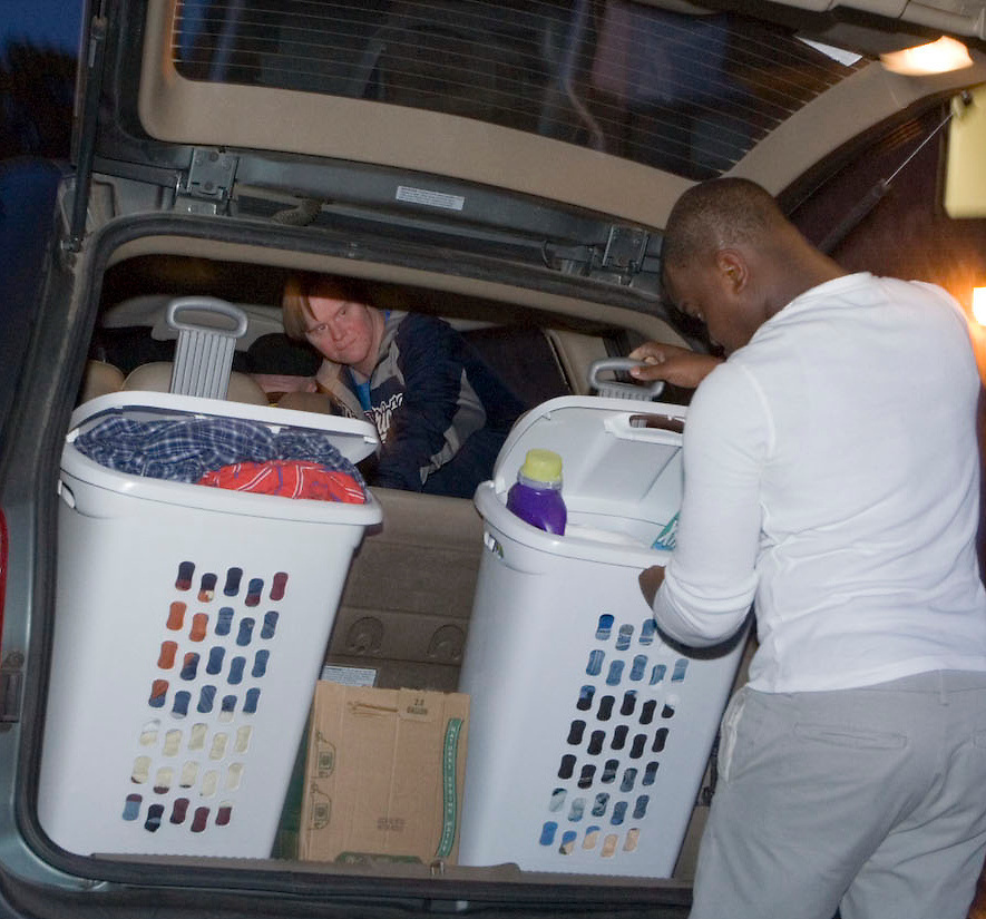 Checking that everything is ready to go, Aaron takes the men to do laundry.