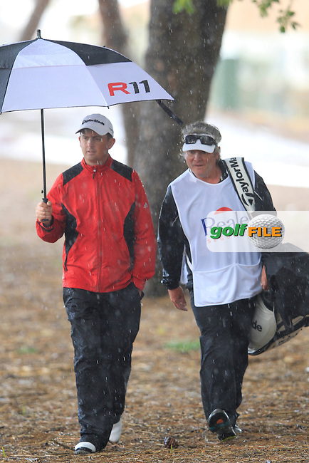 A stroll through the trees for Peter Lawrie (IRL) and caddy Bo at the 5th hole during Thursday's Round 1 of the Open de Espana at Real Club de Golf de Sevilla, Seville, Spain, 3rd May 2012 (Photo Eoin Clarke/www.golffile.ie)