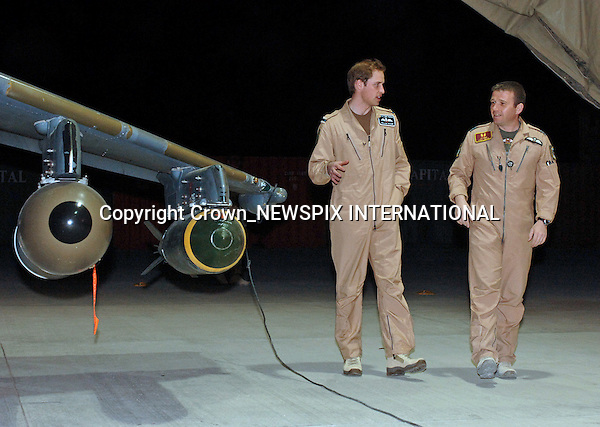 """PRINCE WILLIAM (Flying Officer) VISITS  KANDAHAR AIRFIELD UNIT.during the final phase of his training with the Royal Air Force (RAF). .Fg Off Wales receives a brief on the Harrier GR7A from Wing Commander (Wg Cdr) Andy Lewis, Kandahar Airfield (KAF) Air Terminal, Afghanistan_29/04/2008.Photo Credit: I Houlding_Newspix International..**ALL FEES PAYABLE TO: """"NEWSPIX INTERNATIONAL""""**..PHOTO CREDIT MANDATORY!!: NEWSPIX INTERNATIONAL(Failure to credit will incur a surcharge of 100% of reproduction fees)..IMMEDIATE CONFIRMATION OF USAGE REQUIRED:.Newspix International, 31 Chinnery Hill, Bishop's Stortford, ENGLAND CM23 3PS.Tel:+441279 324672  ; Fax: +441279656877.Mobile:  0777568 1153.e-mail: info@newspixinternational.co.uk"""