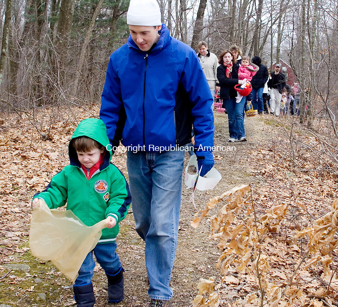 WOODBURY, CT- 16 MARCH 2008- 031608JT08-<br /> Owen Hale, 3, of Woodbury, walks with his father Steve toward a field scattered with Easter eggs at Flanders Nature Center in Woodbury on Sunday during the Family Fun egg hunt. <br /> Josalee Thrift / Republican-American