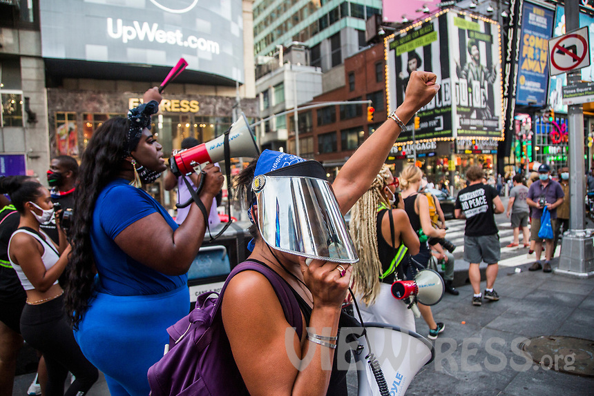 "NEW YORK, NY - JULY 26: A woman wearing face goggles directs the crowd of protesters in Times Square in New York, NY on July 26, 2020. Hundreds of New York activists participated in a march to condemn the They see it as an excessive focus of federal authorities in Portland, Oregon and continue to support the different movements of ""Black Lives Matter"" (Photo by Pablo Monsalve / VIEWpress via Getty Images)"