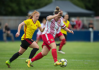 Chloe Gunn of Stevenage Ladies moves from Merrick Will of Watford Ladies during the pre season friendly match between Stevenage Ladies FC and Watford Ladies at The County Ground, Letchworth Garden City, England on 16 July 2017. Photo by Andy Rowland / PRiME Media Images.