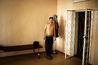 A detainee at Specialised Prison Colony 27 who has MDR TB (multi-drug-resistant tuberculosis), waits to be X-rayed. Kyrgyzstan's prisons are experiencing a TB epidemic, where the incidence rate is estimated at 25 times higher than in civil society.