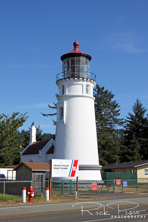 The Umpqua River Lighthouse towers above the entrance to Winchester Bay along the Oregon coast. The lamp was lit for the first time on December 31, 1894, with a signature of two white flashes followed by a red flash. <br />